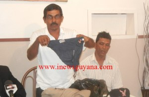 Naith Ram displays his underwear which he claimed the Police stripped during the recent protest in Essequibo.