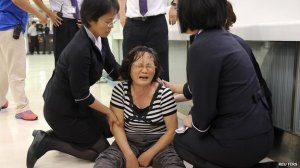 Grief-stricken relatives of people on board the flight had to be comforted by staff in Kaohsiung International Airport