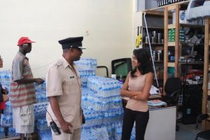 Commander Hicken interacts with business personnel on Regent Street. [iNews' Photo]