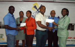 Directors of Boyce/Jefford Classic, Edison Jefford (middle) and Colin Boyce (extreme left) receive cheques from representatives of NaMilCo.  [iNews' Photo]