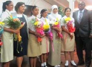 Education Minister, Priya Manickchand and Chief Education Officer, Olato Sam along with some of the top CSEC students. [iNews' Photo]