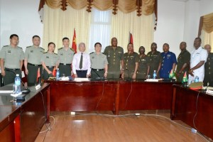 Chinese Ambassador to Guyana Zhang Limin (fifth from left), Major General, Kong Li from the People's Liberation Army of China, Chief of Staff, Guyana Defence Force, Brigadier, Mark Phillips and other delegates representing the two countries at the Guyana-China Bilateral Conference.  [GINA Photo]