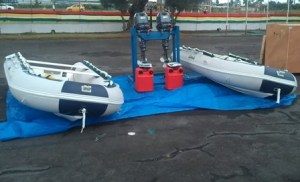 Chinese Military Donation: two inflatable craft with outboard engines.  [iNews' Photo]