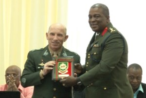 Chief of Staff of the GDF, Brigadier Mark Phillips presents a plaque to The General heading Brazil's delegation, Lieutenant Decio Luis Schons.