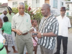 Opposition Leader, David Granger [left], Shadow Home Affairs Minister, Winston Felix and one of Granger's body guard behind.