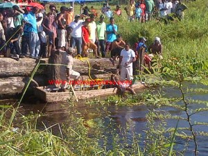 Residents search the canal for the teen.