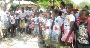 Tiger Bay and Albouystown children pose with their fabric painted t-Shirts which they designed during a session on camp. [iNews' Photo]
