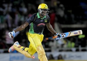Andre Russel celebrates critical win for Jamaica Tallawahs.