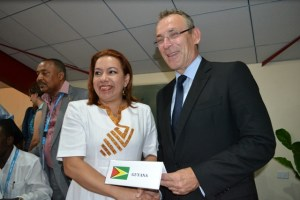 Minister Carolyn Rodrigues Birkett and Andris Piebalgs.