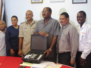 GCCI's President, Lance Hinds [center], Police Commissioner (ag), Seelall Persaud and others. [iNews' Photo]