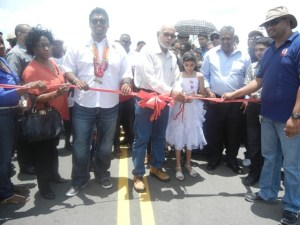 Housing Minister, Irfaan Ali, President Donald Ramotar and residents during the commissioning of the road. [iNews' Photo]