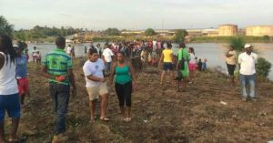 Residents gather to search for the body.