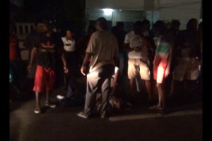 Persons gather around one of the injured men. [iNews' Photo]