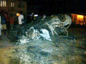 The burnt car following the accident. [Photo taken from Kaieteur News]
