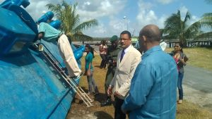 Head of CANU: James Singh and Minister Clement Rohee  along with the media inspect the vessel