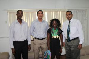 Dr Frank Anthony (extreme right) as he conversates with Alisha Fortune (second right) in the presence of Alfred King and Silas Brummel.
