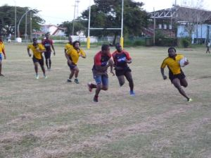 Theodore Henry makes a move to score for the Caribs