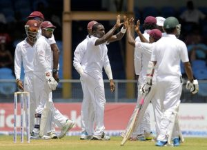Jerome Taylor and the West Indies celebrate the fall of a wicket.