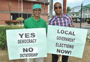 APNU Leader, David Granger and Head of Blue CAPS, Clinton Urling during the picket exercise today.