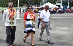 """Prime Minister, Samuel Hinds, Education Minister, Priya Manickchand and Agriculture Minister Dr Leslie Ramsammy arrive at the National Park to witness the distribution of the Government's 'Because We Care"""" education grant. [GINA's Photo]"""