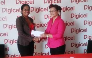 Caption Juditha DaCosta (right) receives the ceremonial cheque from Digicel's representative, Vidya Sanichara. [iNews' Photo]