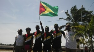 The male cyclists celebrate their win by hoisting the National Flag