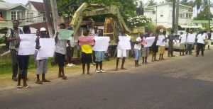 Some of the Plaisance residents protesting this morning. [iNews' Photo]
