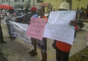 Members of the LGBT Community protest in front of the Georgetown Magistrates' Court.