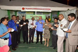 President Donald Ramotar, First Lady Deolatchmee Ramotar, Prime Minister Samuel Hinds and other members of Government taking a taste of locally produced rice cereal. [GINA Photo]