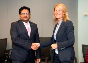 Minister of Finance Singh, Dr. Ashni Singh shakes hands with Sophie Sirtaine, Director of the Caribbean Country Management Unit of the World Bank after the signing of the agreements (Photo courtesy World Bank)