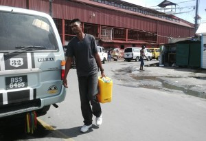 Fisherman Mohan Sukhan travelled from Canal Number One, West Bank Demerara to purchase fuel in Georgetown so that he can operate his boat. [iNews' Photo]