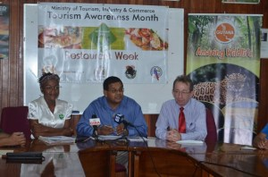 Director of the Guyana Tourism Authority Indranauth Haralsingh and staff, along with the President of the Tourism and Hospitality Association of Guyana, Shaun McGrath addressing the media. [GINA Photo]