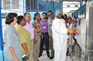 Staff of the Georgetown Public Hospital Corporation looking on as the technician explains parts of the machinery and its functions. [GINA Photo]