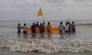 Members of the Alexander Village Vishnu Mandir performing Puja this morning at Band Stand Sea Wall