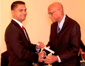 Dr Dukhi receives his certificate from Head of Neurosurgery in Cuba, Professor  Esteban Roig
