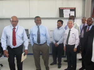 Prime MInister, Samuel Hinds [center], CEO of GPL Bharrat Dindyal [left] and other officials at the new substation. [iNews' Photo]