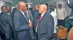 President Donald Ramotar in discussion with Opposition Member, Joseph Harmon at the opening of the 10th Parliament.