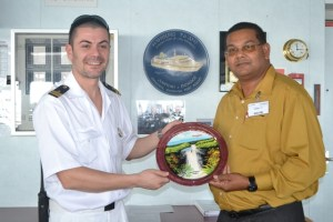 Director of the Guyana Tourism Authority (GTA) Indranauth Haralsingh handing over a token to one of the crew members of the cruise ship, Vista Mar.