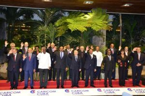 President Donald Ramotar (2nd left front row) among Caricom leaders and Cuban President Raul Castro at the end of the Fifth Caricom-Cuba summit