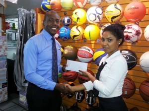 Giftland OfficeMax Marketing Representative, Delroy Dash (left) handing over the cheque to the 'Respect the Game's' Director, Surika Danraj. Saved as sponsorship