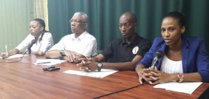 APNU Leader, David Granger flanked by Chairman of the youth arm of the PNCR, Ryan Belgrave; Executive Member, Nia Gonsalves (right) and General Council Member, Malika Ramsey. [iNews' Photo]