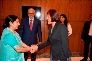 First Lady Deolatchmee Ramotar is warmly greeted by Minister of External Affairs and Overseas Indian Affairs, Sushma Swaraj.  President Donald Ramotar looks on.