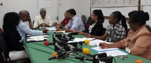 GECOM officials meet with representatives from the NCD.