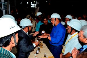 President Donald Ramotar and an official discussing the finer points of production during his tour of the Valsad sugar factory.