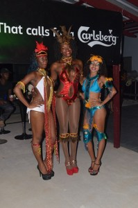 Three models displaying some of the Park Vue hotel's Mashramani costumes