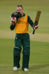Morne van Wyk kisses his helmet after making his T20 century.