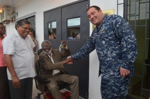Lieutenant Commander Robert Novotny, Commander U.S. Military Liaison Office handing over the keys to the building to Dr. Roger Luncheon, Defence Board Secretary and National Disaster Coordinator