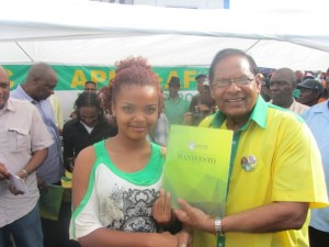 APNU+AFC Prime Ministerial Candidate Moses Nagamootoo presents the manifesto to one of the supporters. [iNews' Photo]