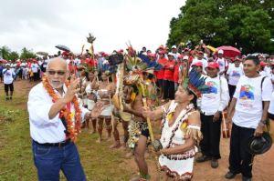President Donald Ramotar gets a traditional Amerindian welcome at Aishalton, Region Nine
