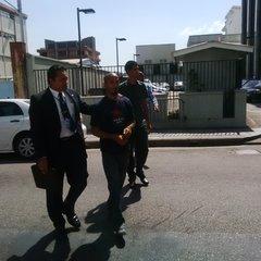 Balkumar Singh, on his way to court in Trinidad and Tobago